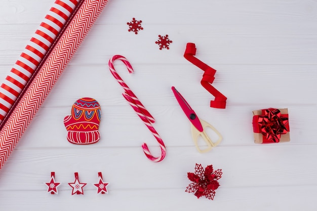 Christmas present with decorations on wooden background how to decorate christmas gift at home