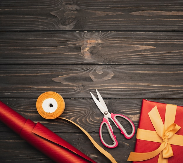 Christmas present with golden ribbon and scissors