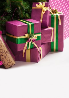 Christmas presents under a holiday tree