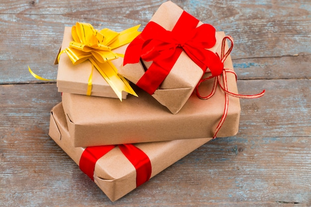 Christmas presents laid on a wooden table background.