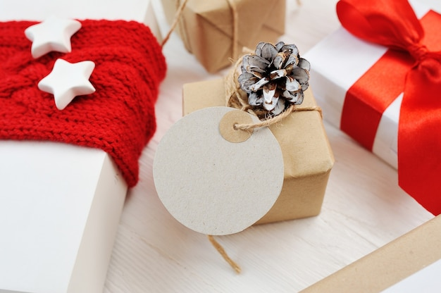 Christmas presents with pine cone and ribbon Premium Photo
