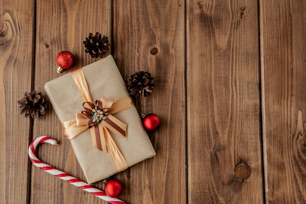 Christmas presents with ribbon on dark wooden  in vintage style