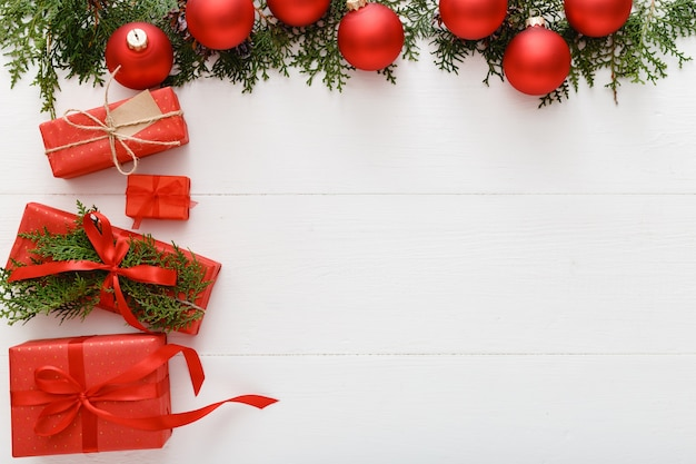 Christmas presents xmas gifts boxes red festive decor on white wooden background.copy space new year