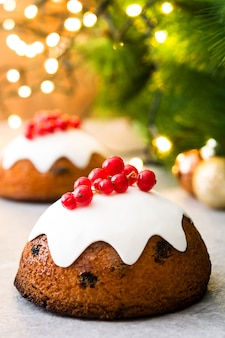 Christmas pudding and christmas light on gray