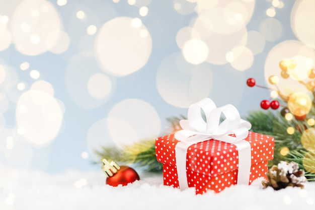 Christmas red gift with branch fir tree and decorations