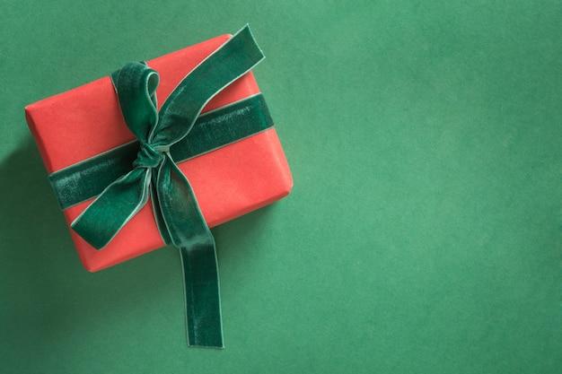 Christmas red gift with green velvet ribbon