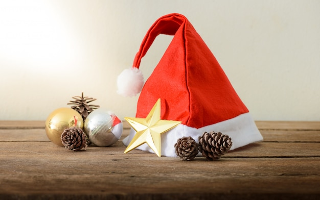 Christmas red hat on a wooden background