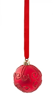 Christmas red ornament hanging from ribbon on white