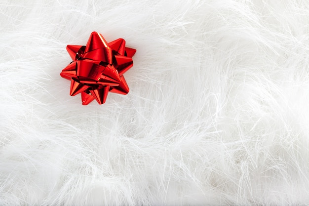 Christmas red ribbon look over white fur