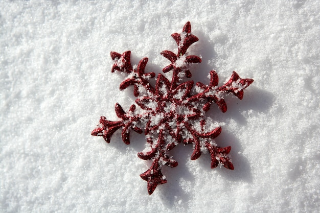 Christmas red star in a snow day background