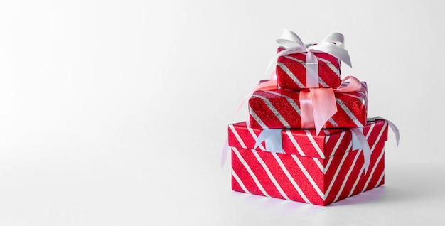 Christmas red striped gift boxes on light background. creative minimal composition.