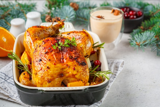 Christmas roasted chicken with cranberries, orange, spices and herbs. christmas food concept.