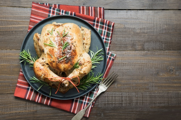 Christmas roasted chicken with spices and rosemary.