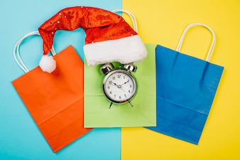 Christmas sales concept with hat and alarm