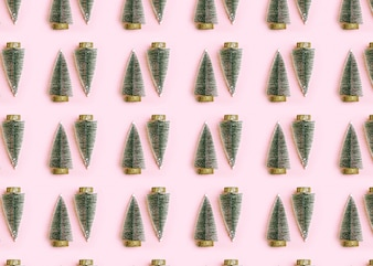Christmas seamless pattern. Christmas background with christmas tree pink isolated over ba