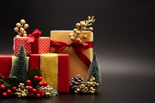Christmas season background and happy new year gift box on black background