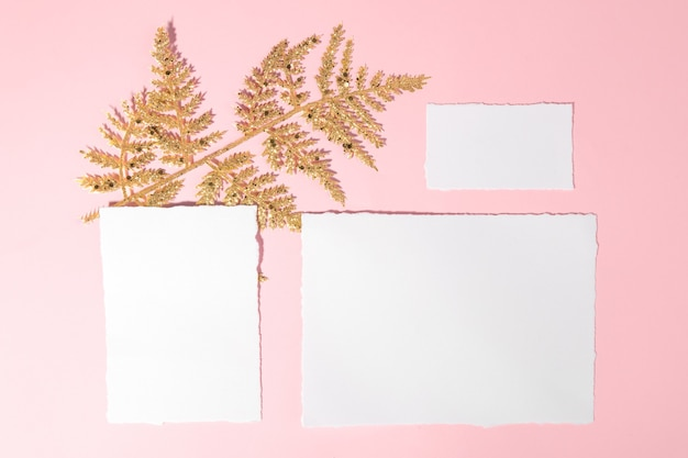 Christmas set of cards with golden festive decoration on a pink pastel background.