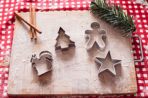 Christmas shapes pastry cutters on wooden board