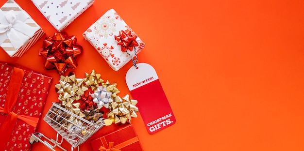 Christmas shopping composition with presents and cart