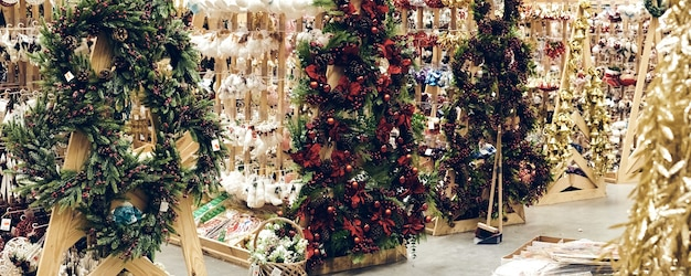 Christmas shopping during a pandemic. stores sales holiday decorations, bubble toys and tinsels. christmas market festive mood