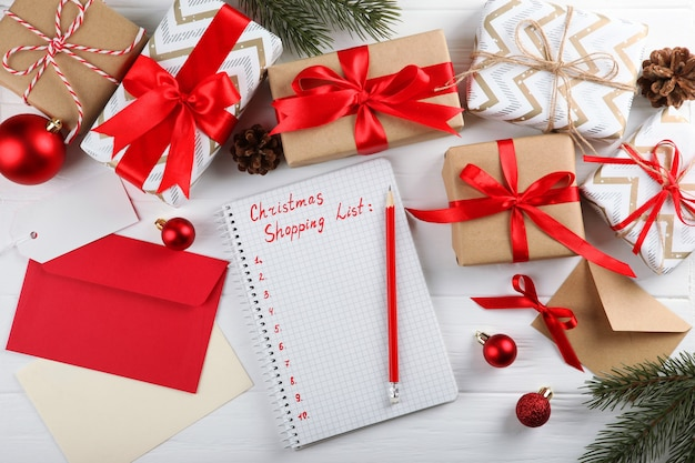 Christmas shopping list composition on the theme of christmas shopping top view