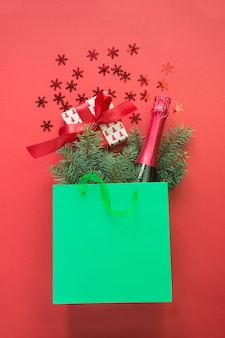 Christmas shopping paper bag with and gift box and champagne