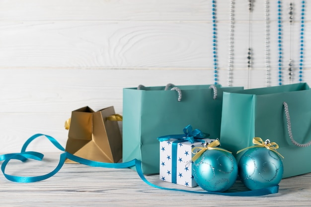 Christmas shopping sale composition with blue paper bags and decorations