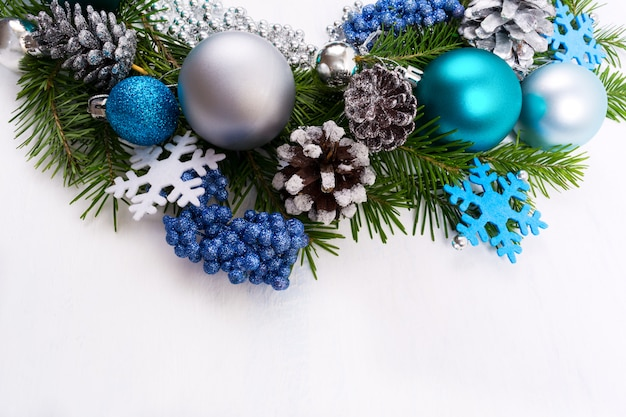 Christmas silver, blue, turquoise baubles on white background