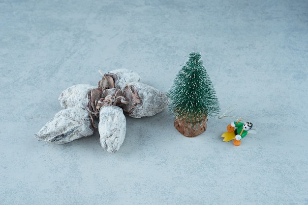 Christmas small tree with healthy dried fruits on marble background. high quality photo