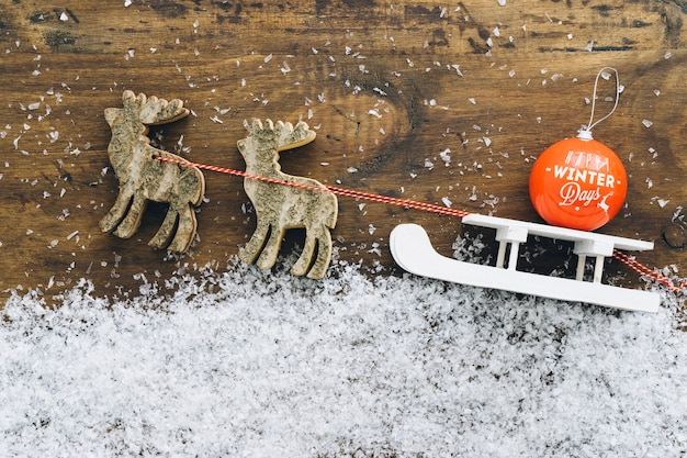 Christmas snow decoration with ball on sled