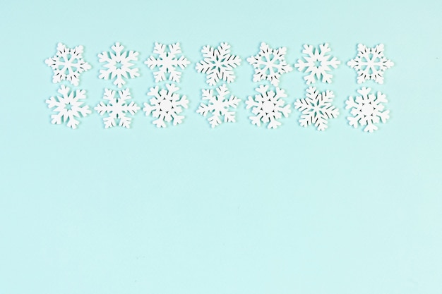 Christmas snowflakes ornaments on blue table