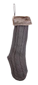 白い表面に分離されたクリスマスの靴下