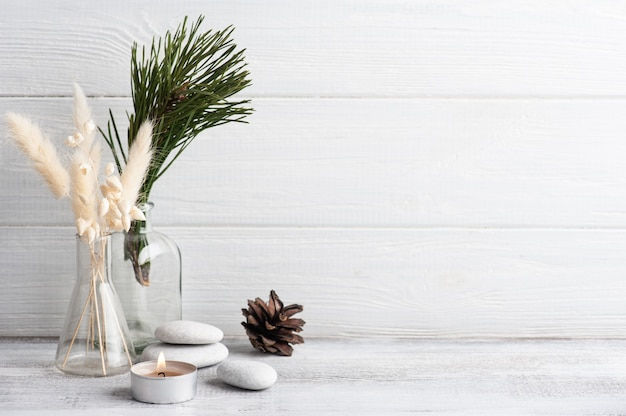 Christmas spa composition with pine tree branches and lit candle. beauty wellness, body care treatment.
