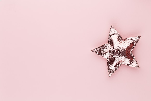 Christmas star decor on pastel colored background christmas or new year minimal concept