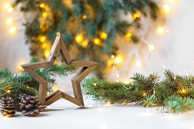 Christmas star, fir branches, new year decorations, notepad on light