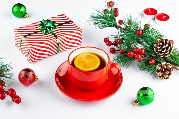 Christmas still life with tea and lemon slice and christmas plants