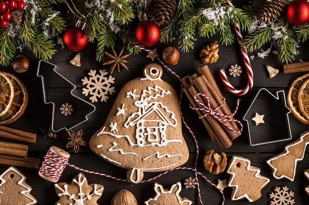 Christmas still life with traditional gingerbread cookies on woo