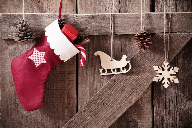 Christmas stockingwith gifts on  wooden wall