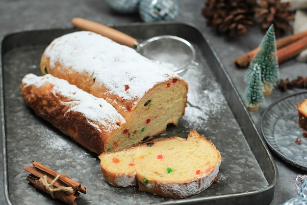 Christmas stollen on rustic background. traditional christmas festive pastry dessert from german. stollen for christmas.