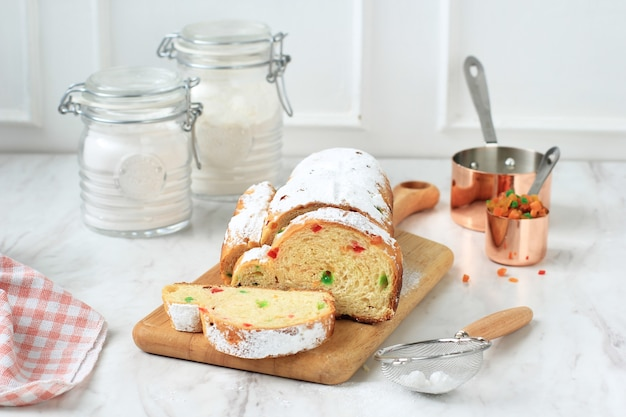 Christmas stollen traditional fruit bread stollen holiday treats for family before dusting with sugar powder, fresh baked