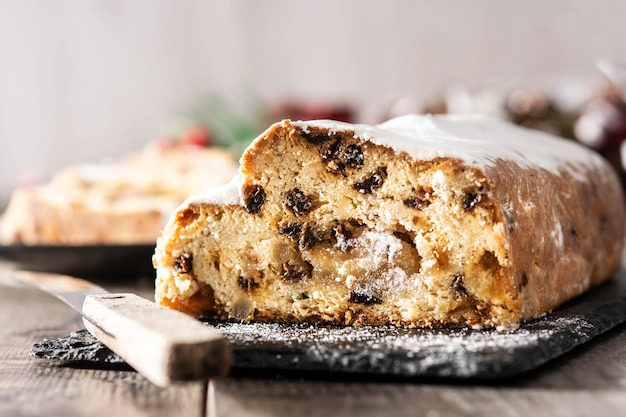 Christmas stollen traditional german christmas dessert on wooden table