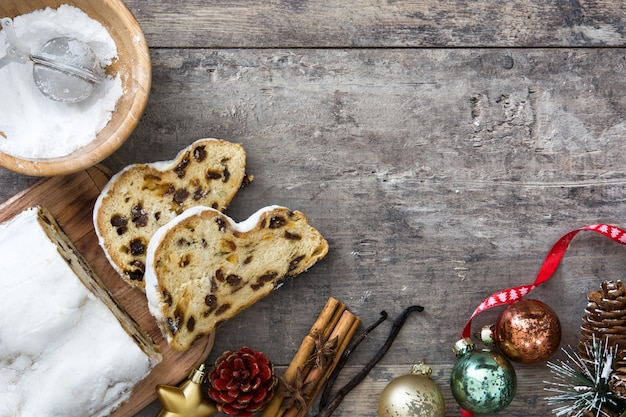 Christmas stollen traditional german christmas dessert on wooden   top view copyspace