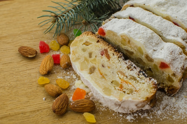 Christmas stollen with fir twigs, nuts and berries