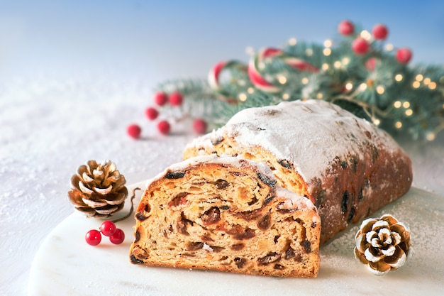 Christmas stollen with fir twigs and trinkets