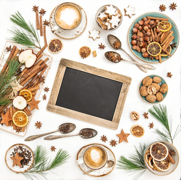Christmas table decoration, chalkboard, cookies with coffee. flat lay. still life