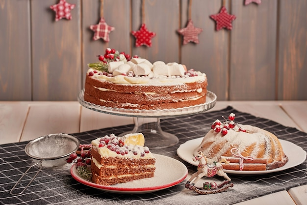 Christmas table decoration, festive fruitcake with sweets on the table