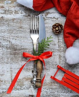 Christmas table place setting and santa claus hat