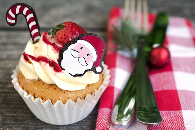 Christmas table place setting with cupcake