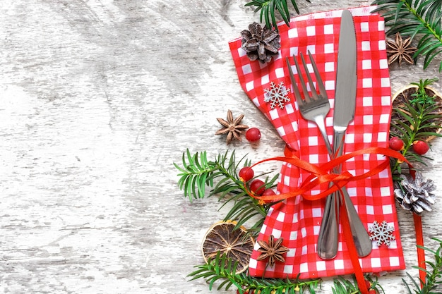 Christmas table place setting with festive decorations