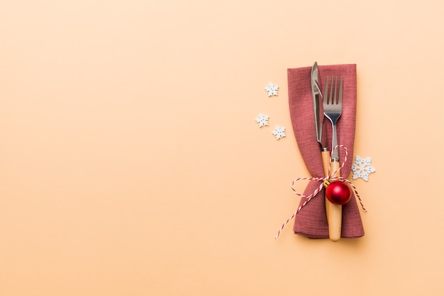 Christmas table place setting with knife, napkin and fork. holidays new year background with copy space